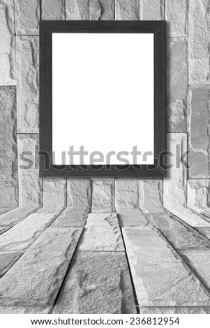 wooden picture frame on brick wall. - stock photo