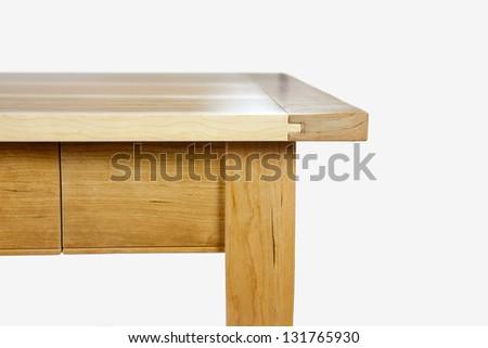 wooden piece of furniture - Edge of a table in front of white blackground - stock photo