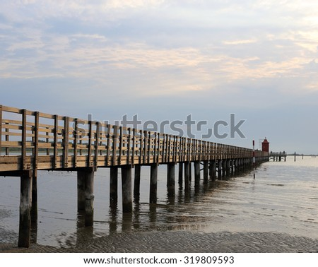Wooden pier and lighthouse