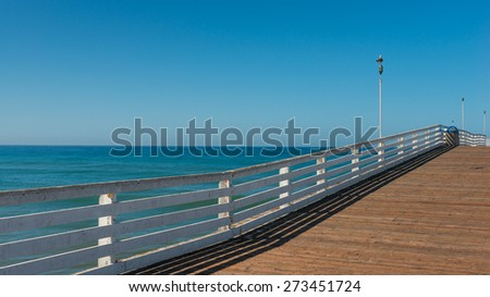 Wooden pier and ocean to the horizon. Decreases, diminishing perspective.   - stock photo