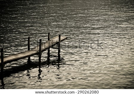 Wooden pier by the lake: silent place concept - toned image