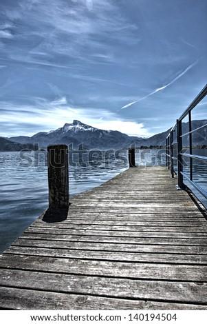 wooden pier in Mondsee,Austria - stock photo