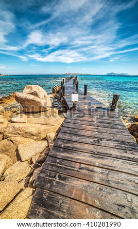 wooden pier in Romazzino beach, Sardinia - stock photo