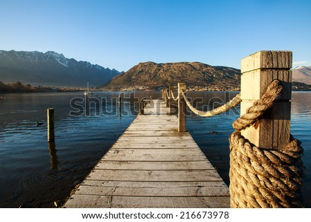 Wooden pier in the morning at Lake Wakatipu, Queenstown, New Zealand - stock photo
