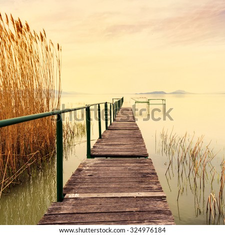 Wooden pier in tranquil lake Balaton-Hungary - stock photo