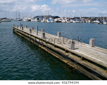 Wooden pier jetty in a marina great marine sailing background image - stock photo