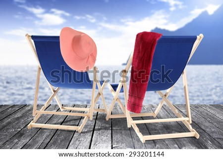 wooden pier of two chairs and decoration  - stock photo