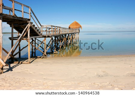 Wooden pier on a tropical beach Mozambique, southern Africa  - stock photo