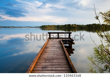 wooden pier on big lake in Groningen - stock photo