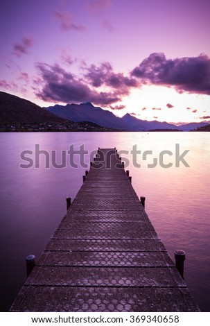 wooden pier on Lake Wakatipu  in Queenstown, New Zealand - stock photo