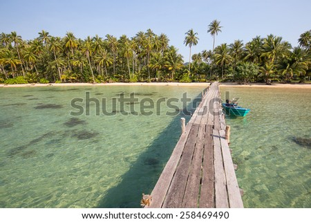 Wooden pier on the beach of Koh Kood island - stock photo