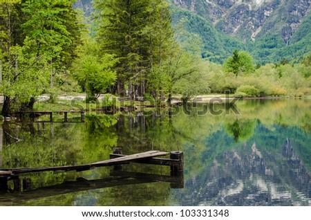 Wooden pier on the mountain lake - stock photo