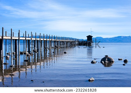 Wooden pier on the Tahoe lake - stock photo