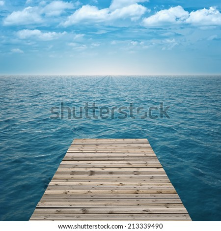 Wooden pier to the sea - stock photo