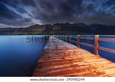 Wooden pier, Wakatipu Lake at dawn, Glenorchy, New Zealand  - stock photo