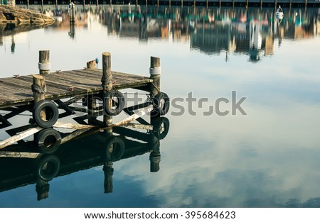 Wooden piers into  crystal clear water at the lake