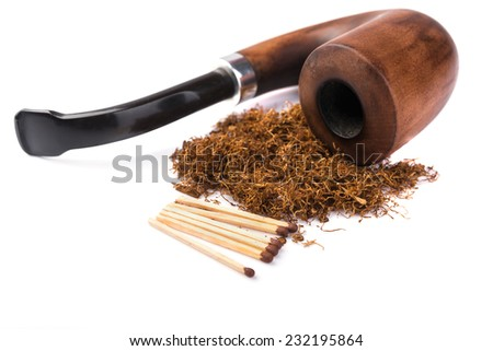 Wooden   pipe with dried tobacco leaves isolated in white background