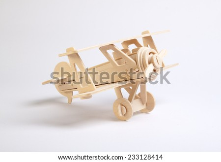 wooden plane on a white background - stock photo