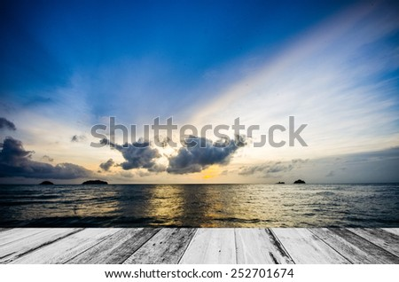 Wooden plank and Beautiful evening sea and sky. - stock photo
