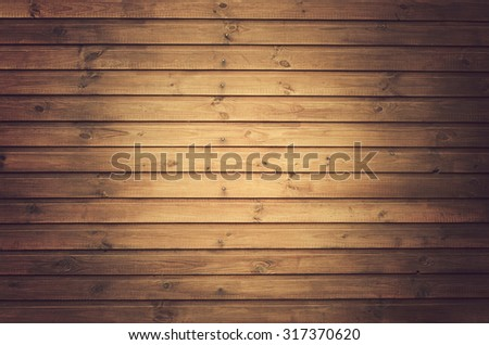 Wooden plank tinting background, grunge  material. Wall made of wooden planks with a light spot in the center - stock photo