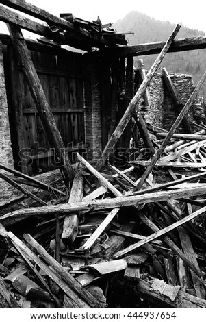wooden planks and rubble and the ruins of the house completely destroyed by powerful earthquake
