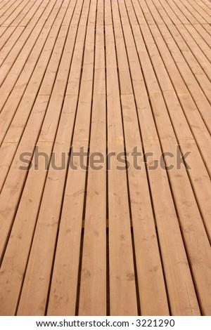 Wooden planks floor fading away to the horizon - stock photo