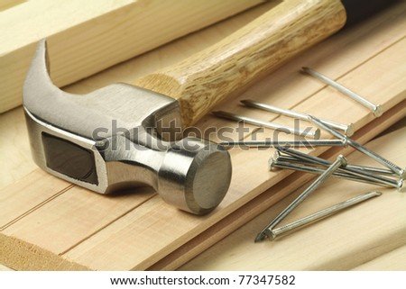 Wooden planks, hammer and nails. - stock photo
