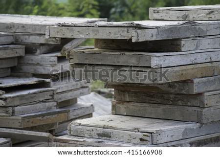 Wooden planks in construction site for work - stock photo