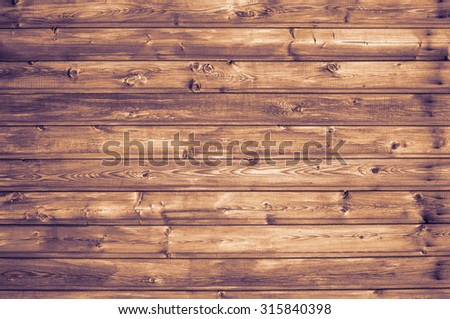 Wooden planks nailed to the wall studs