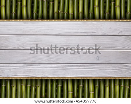 Wooden planks on bamboo stick background