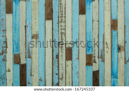 wooden planks texture with cracked color paint for background.