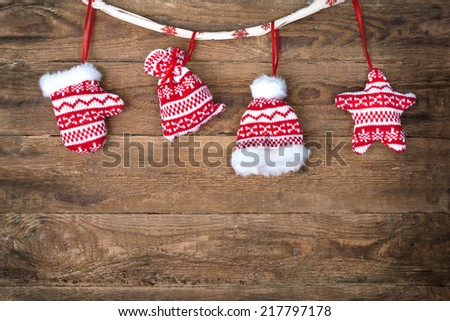 Wooden plaque with a Christmas greeting, Christmas decorations: star,glove,hat and bag - stock photo