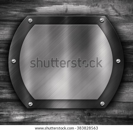 Wooden plaque with silver frame on black wooden background