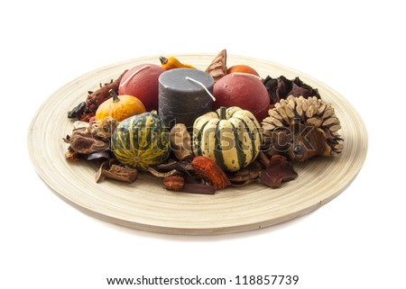 Wooden plate with decorated stuff isolated over white