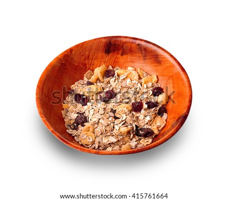 Wooden plate with muesli carved on a white background - stock photo