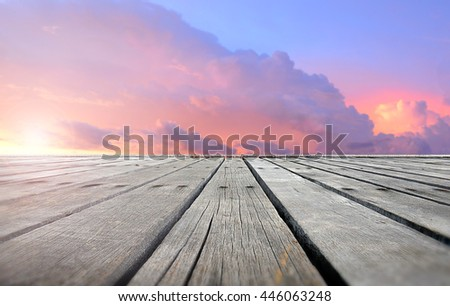 Wooden plates with sunset sky ,clouds warm color and low lighting for background or wallpaper - stock photo