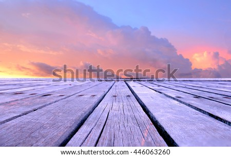 Wooden plates with sunset sky ,clouds warm purple color tone and low lighting for background or wallpaper - stock photo