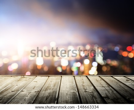 wooden platform and lights of night Hong Kong - stock photo