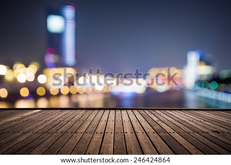 wooden platform and lights of night,shanghai china. - stock photo