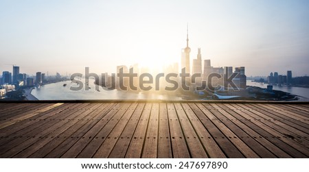 wooden platform and lights sunrise in shagnhai china. - stock photo