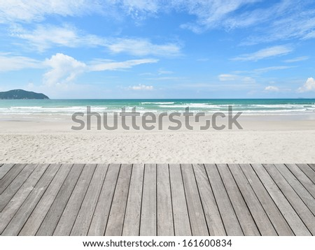 Wooden platform beside tropical beach - stock photo