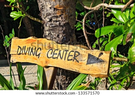 Wooden pointer to the diving center on island Biyadhoo, Maldives, The Indian Ocean - stock photo
