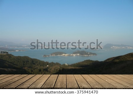 Wooden porch of the house in front of the Hong Kong Island beach in the evening blurred background. - stock photo