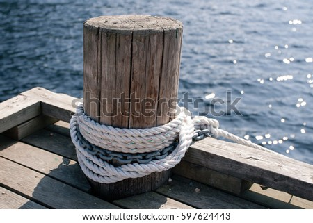 stock-photo-wooden-post-with-mooring-rop