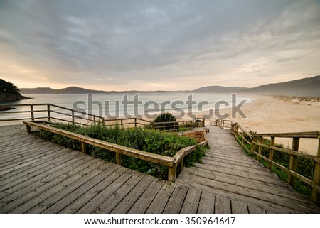 Wooden promenade with a beautiful view of San Jorge beach, Ferrol, Galicia, Spain,