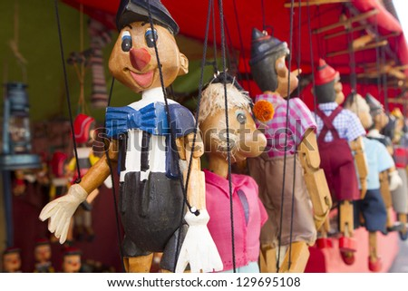 wooden puppet group in a market stall - stock photo