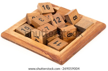 wooden puzzle, isolated image composite wooden figures for the development of logical thinking - stock photo