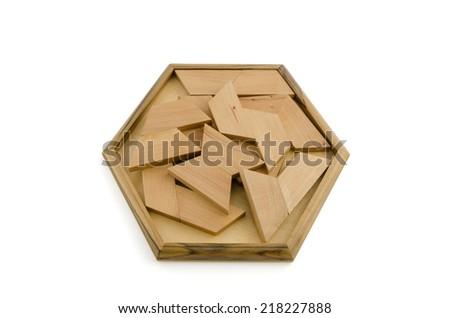 wooden puzzle isolated on white background - stock photo