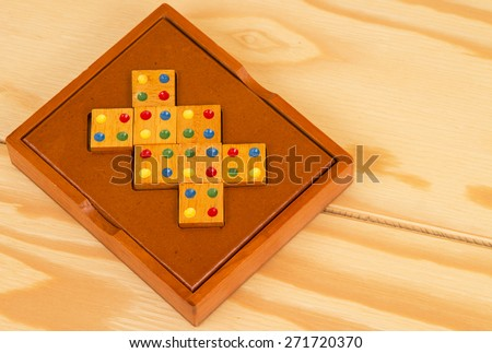 wooden puzzle on the table. Composite wooden figures for the development of logical thinking. - stock photo