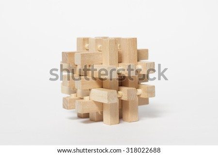 wooden puzzle toy isolated on a white background